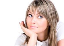Junge Frau, die beiseite schaut Lizenzfreies Stockfoto