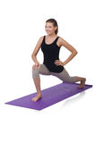 Junge Frau, die Übungen tut Stockfotos