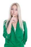 Junge Frau, die das stille Zeichen lokalisiert auf Weiß macht. Stockfotos
