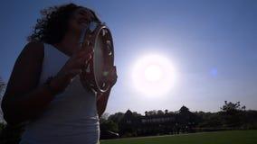 Junge Frau, die das Tamburin spielt stock video footage