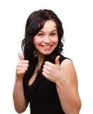 Junge Frau, die Daumen herauf Geste zeigt lizenzfreie stockfotos