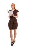 Junge Frau, die denkend steht Lizenzfreie Stockbilder