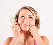 Junge Frau, die Dollarscheine hält Lizenzfreies Stockfoto