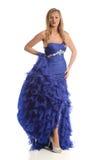 Junge Frau, die ein blaues Kleid trägt Stockbild