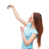 Junge Frau, die ein Foto von mit Kamera macht lizenzfreie stockfotografie