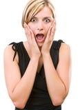 Junge Frau, die ihre Überraschung zeigt Lizenzfreie Stockfotografie