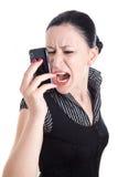 Junge Frau, die in ihrem intelligenten Telefon bawling ist Lizenzfreie Stockfotografie
