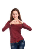 Junge Frau, die Innerform mit den Händen bildet Stockbilder