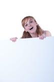 Junge Frau, die mit einem Plakat aufwirft Lizenzfreie Stockfotografie
