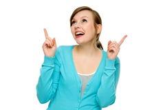 Junge Frau, die oben zeigt Lizenzfreie Stockfotos