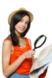 Junge Frau, die Reisenzieleinheit wählt Lizenzfreie Stockfotos