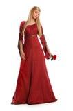 Junge Frau, die rote Rose anhält stockbilder
