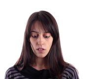Junge Frau, die unten schaut Lizenzfreie Stockfotos