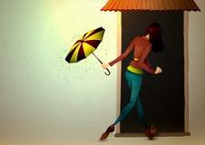 Junge Frau, die vom Regen mit Regenschirm sich versteckt Lizenzfreie Stockfotos