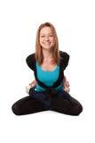 Junge Frau, die Yoga tut Stockfotos