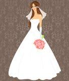 Junge Frau in einem Hochzeitskleid Stockfotografie