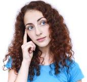 Junge Frau in einer durchdachten Haltung stockbilder