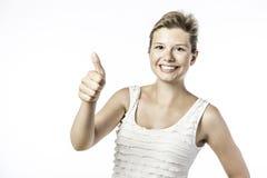 Junge Frau hält ihr tumb hoch stockbilder