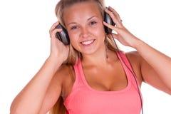 Junge Frau hören Musik stockbilder