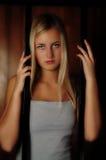 Junge Frau hinter Stäben Lizenzfreie Stockfotos
