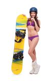 Junge Frau im Badeanzug mit Snowboard Stockfotografie