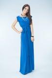 Junge Frau im blauen Kleid Lizenzfreie Stockfotografie