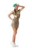 Junge Frau im Gold Mini Dress Posing Stockfoto