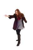 Junge Frau im Mantel und in den Stiefeln Lizenzfreies Stockbild