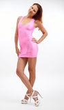 Junge Frau im rosa Kleid lizenzfreie stockfotografie