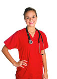 Junge Frau im Rot scheuert sich Stockfotos
