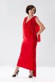 Junge Frau im roten Kleid lizenzfreie stockfotografie