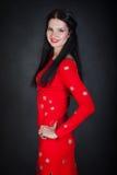 Junge Frau im roten Kleid Stockfoto
