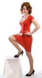 Junge Frau im roten Kleid Stockfotos
