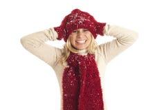 Junge Frau im Schnee lizenzfreie stockfotos