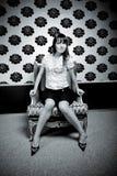 Junge Frau im Stuhl Stockbilder