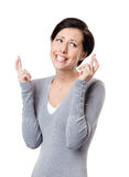 Junge Frau kreuzt Finger Lizenzfreie Stockfotografie