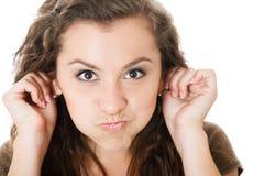 Junge Frau machen Gesichter Lizenzfreie Stockfotografie