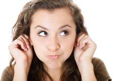 Junge Frau machen Gesichter Lizenzfreie Stockbilder