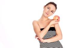 Junge Frau mit Apfel Stockfoto