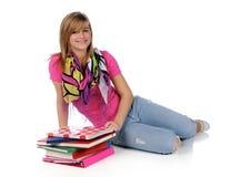 Junge Frau mit Büchern stockfoto