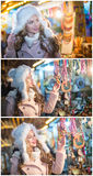 Junge Frau mit bewundern Zubehör der weißen Pelzmütze in Weihnachtsmarkt, kalter Winterabend Schönes blondes Mädchen in der Winte Stockfotografie