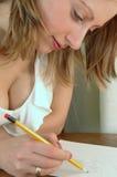 Junge Frau mit Bleistift Lizenzfreie Stockbilder