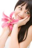 Junge Frau mit Blume Stockbild