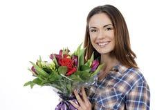 Junge Frau mit Blumenstrauß Lizenzfreie Stockbilder