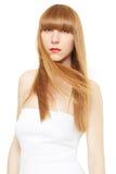 Junge Frau mit dem blonden, langen, geraden Haar im Wind Stockbilder
