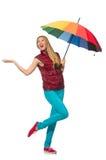 Junge Frau mit dem bunten Regenschirm lokalisiert Stockfoto