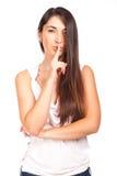 Junge Frau mit dem Finger auf Lippen Stockfotos