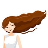 Junge Frau mit dem langen gelockten braunen Haar Lizenzfreies Stockfoto