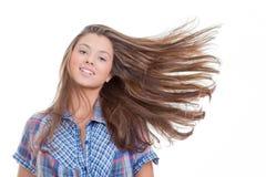 Junge Frau mit dem langen gesunden Haar Stockfotos