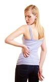Junge Frau mit den rückseitigen Schmerz Stockfotografie